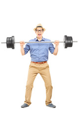 Full length portrait of a casual guy lifting a weight