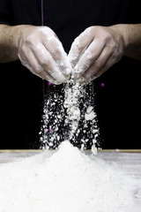 hands dropping flour