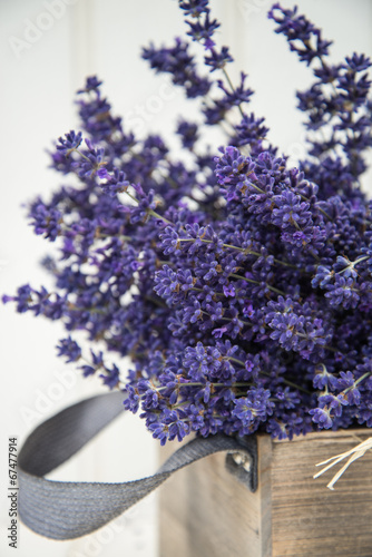 Foto op Canvas Lavendel Beautiful fragrant lavender bunch in rustic home styled setting
