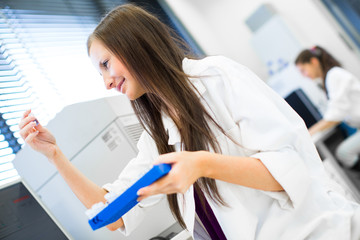 Portrait of a female chemistry student in lab