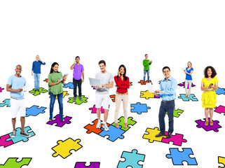 Multi-Ethinic People Standing On Puzzle Pieces