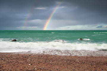 beautiful rainbow over ocean coast