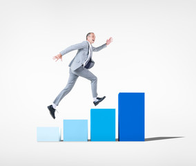 Businessman Running on Bar Graph