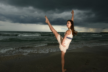 Young woman dancing on a beach