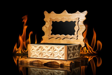 old brown wooden casket in fire flame on black background
