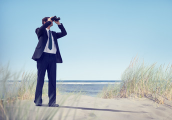 Businessman Holding Binocular on the Beach