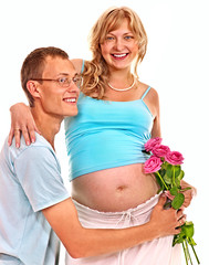 Pregnant woman with husband.