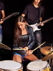 Woman playing  guitar.
