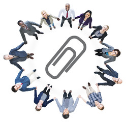 Business People Holding Hands and Paper Clip Symbol