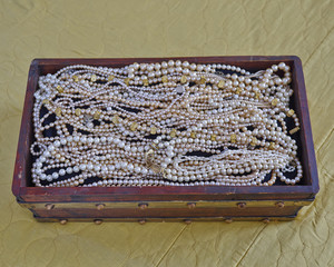 pearls in vintage wooden crib, precious background