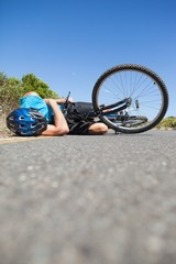 Cyclist lying on the road after an accident