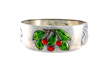 Silver bowl with fruit craved