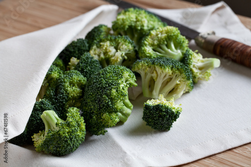 green broccoli on wooden board