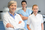 Medical professional team woman at dental surgery