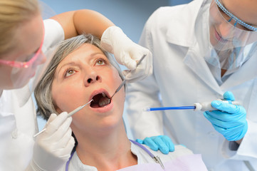 Dental check elderly woman patient dentist team