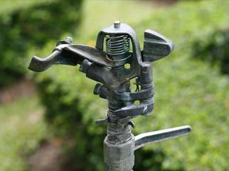 water springer on ground in garden