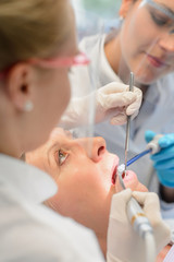 Professional dental team checkup patient woman