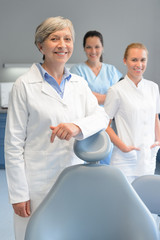 Professional dentist team woman at dental surgery
