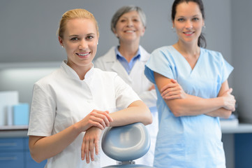 Three professional dentist woman at dental surgery