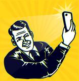 Selfie Fever! Vintage Man takes selfie with smartphone camera