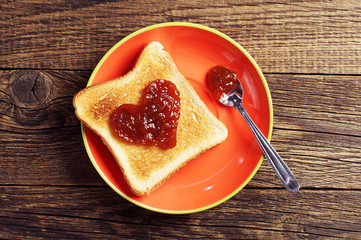 Toast bread with jam in shape of hearts