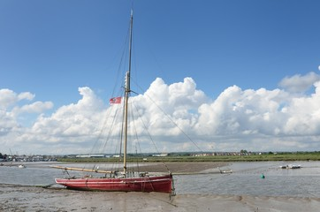 Red boat at low Tide