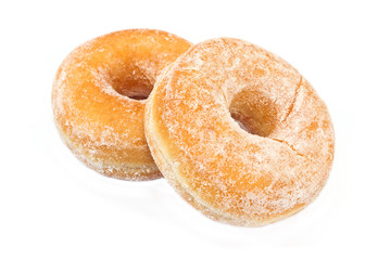 Two donuts powdered with sugar isolated on white