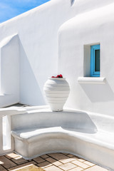 Outside a stylish whitewashed house in Mykonos