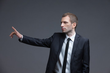 Portrait of businessman pointing hand gestures