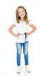 canvas print picture - Cute smiling little girl in jeans isolated