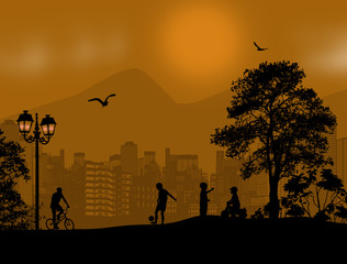 Children playing silhouette on beautiful landscape