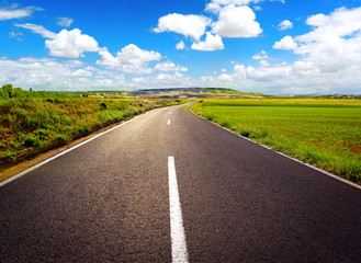 Concept of straight path to success. Asphalt road over blue sky
