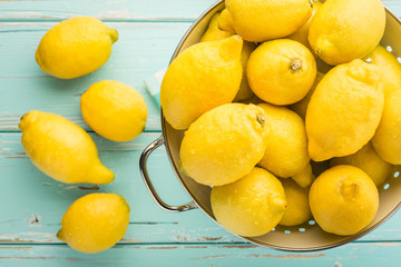 Fresh lemons in retro colander.