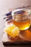 Fototapety honeycomb and honey in jar on wooden background