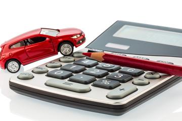 Auto, Rotstift und Taschenrechner