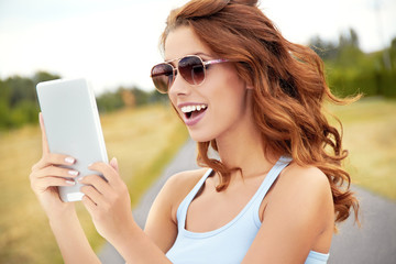 beautiful young happy woman using tablet