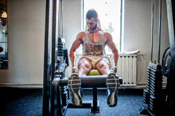 bodybuilder working out and training at the gym, legs and feet