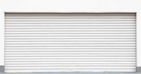 White metal shutters over a shop doors