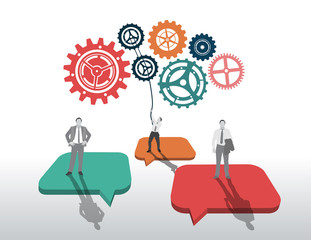 Business people standing on speech bubbles with large cogs and w
