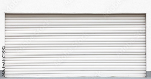 White metal shutters over a shop doors - 67492922