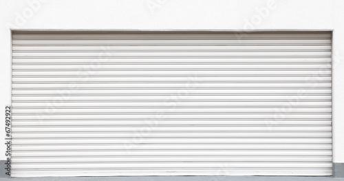 Leinwanddruck Bild White metal shutters over a shop doors
