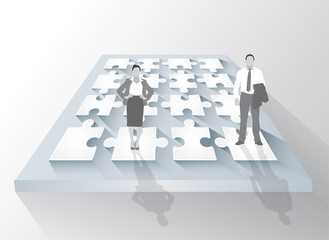 Business people standing on grey panel with white jigsaw pieces
