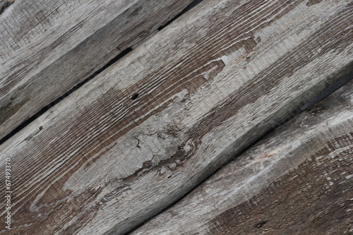 Three old textured boards diagonal background