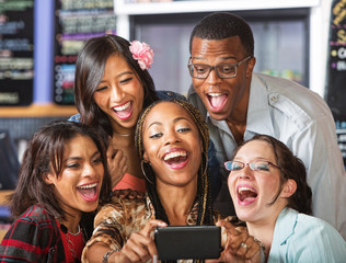 Laughing Students Holding Smartphone