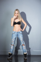 sexy blonde in jeans and bra.
