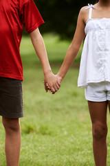 Children in love boy and girl holding hands