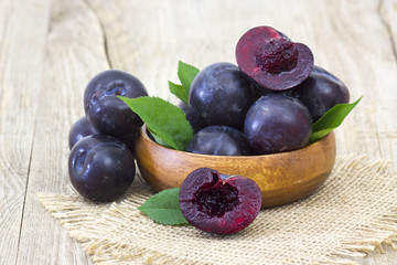 fresh plums in a bowl
