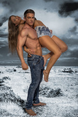 Hunky male carrying female model