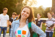 Leinwanddruck Bild - Female smiling student outdoors