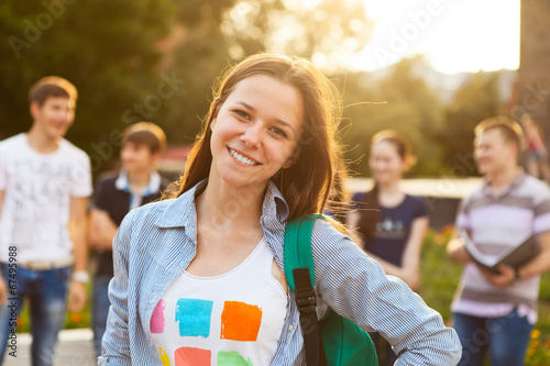 Leinwanddruck Bild Female smiling student outdoors